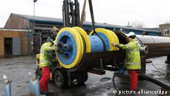 Men working on steel pipe
