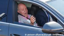 Juan Carlos seated in a car with the window down