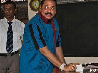 President Mahinda Rajapaksa casts his vote in his home village of Madamulana