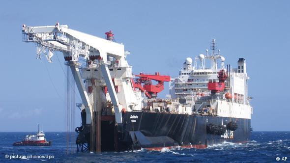 Ship at sea for laying pipes