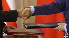 U.S. President Barack Obama, left, shake hands with his Russian counterpart Dmitry Medvedev, right, after signing the newly completed New START treaty reducing long-range nuclear weapons at the Prague Castle in Prague, Czech Republic Thursday, April 8, 2010. (AP Photo/Petr David Josek)