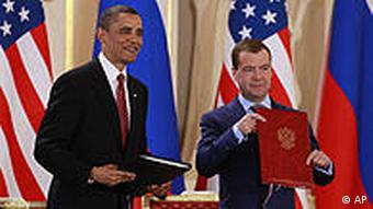 Barack Obama holds the newly-signed START treaty with Russian president Dmitry Medvedev