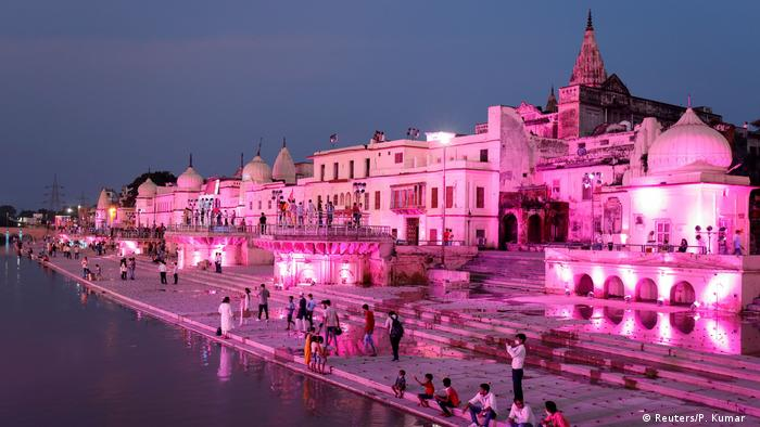 Temples and other buildings on the bank of Sarayu river are seen illuminated ahead of the foundation-laying ceremony for a Hindu temple in Ayodhya, India