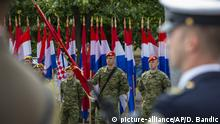 Croatian soldiers attend a ceremony in Knin, Croatia