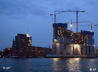 The construction site of the Elbphilharmonic in Hamburg near the harbor at night time