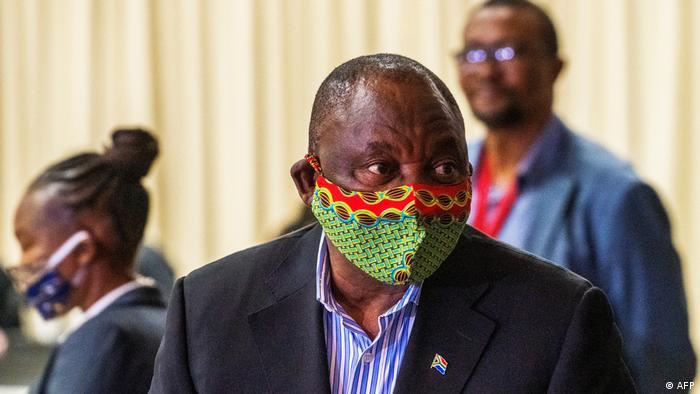 South African President Cyril Ramaphosa wears a mask at a coronavirus treatment center