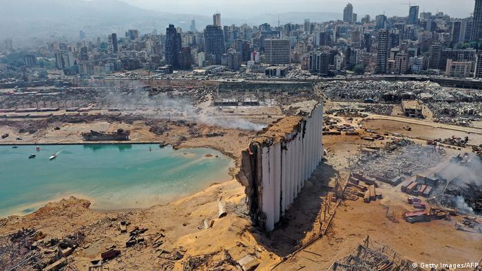 An aerial view shows the massive damage done to Beirut port's grain silos (C) and the area around it on August 5, 2020, one day after a mega-blast tore through the harbour in the heart of the Lebanese capital with the force of an earthquake, killing more than 100 people and injuring over 4,000.(Getty Images/AFP)