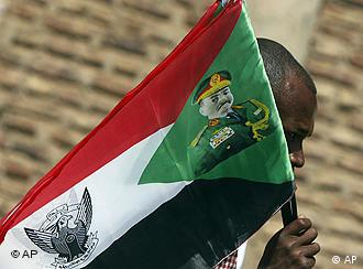 Person carrying Sudanese flag