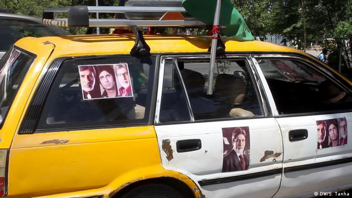 A taxi in Afghanistan decorated with posters of Amitabh Bachchan