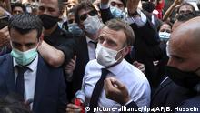 French President Emmanuel Macron, center, wears a mask to help prevent the spread of the coronavirus, as he visits the Gemayzeh neighborhood, which suffered extensive damage from an explosion on Tuesday that hit the seaport of Beirut, Lebanon, Thursday, Aug. 6, 2020. (AP Photo/Bilal Hussein) |