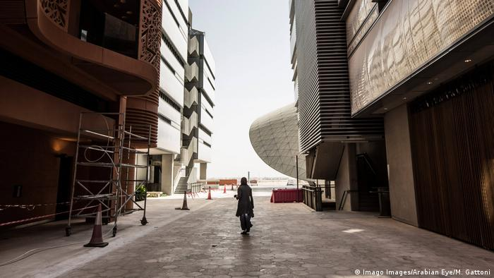 A student walking through the narrow streets on the Masdar Institute of Science and Technology campus