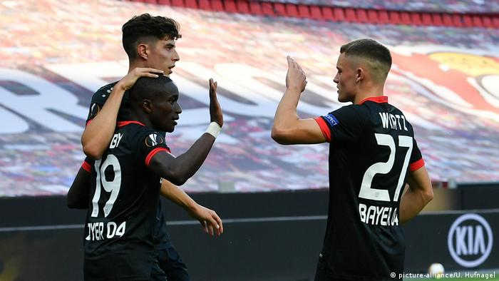 Florian Wirtz and Kai Havertz congratulate goalscorer Moussa Diaby