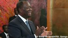 A picture taken on August 5, 2019 shows Ivory Coast President Alassane Ouattara applauding during a ceremony at the presidential palace in Abidjan. - Ivory Coast President Alassane Ouattara said on August 6, 2020 he will contest tense presidential polls in October, which come after years of political turbulence and civil war in the world's top cocoa grower. (Photo by ISSOUF SANOGO / AFP) (Photo by ISSOUF SANOGO/AFP via Getty Images)
