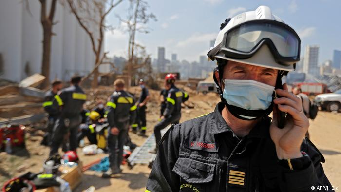A French rescue worker in Beirut talks on the phone (AFP/J. Eid)