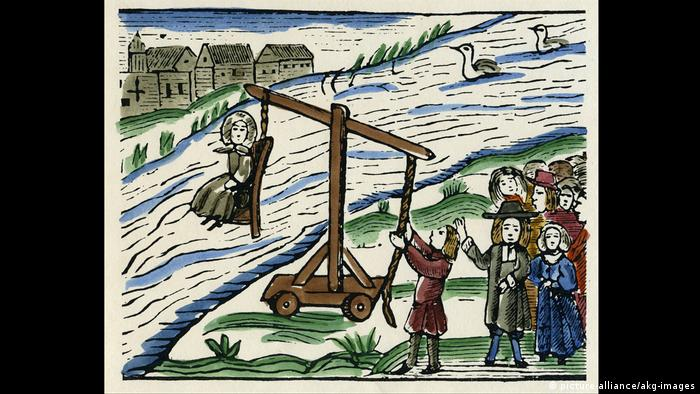 Depiction of a woman on a crane being brought to the river for a so-called swimming test, circa 1600