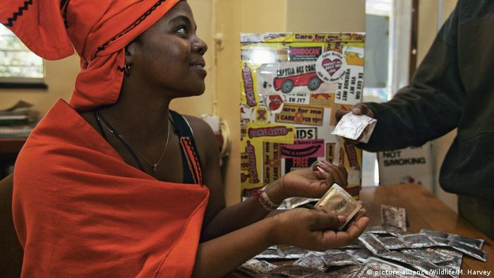 A woman in the Central African Republic receives free condoms.