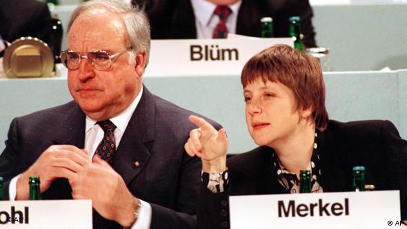 This undated file photo shows then German Women and Youth Minister Angela Merkel, right, beside then Chancellor Helmut Kohl.