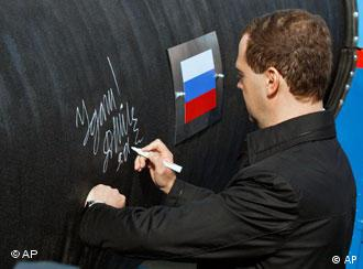 Russian President Medvedev writes a message on the Nord Stream pipeline