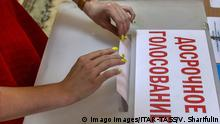 MINSK, BELARUS - AUGUST 8, 2020: A woman casts her ballot into a ballot box at a polling station during an early voting in the 2020 Belarusian presidential election which is held on 4-8 August. The 2020 Belarusian presidential election is scheduled for 9 August. Valery Sharifulin/TASS PUBLICATIONxINxGERxAUTxONLY TS0E2A91