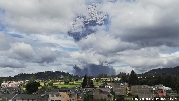 Mount Sinabung spews volcanic materials into the air as it erupts