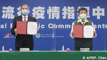 US Health Secretary and Human Rights Services Alex Azar (L) and Taiwan's Minister of Health and Welfare Chen Shih-chung display the signed documents during a memorandum of understanding signing ceremony at the Centers for Disease Control (CDC) in Taipei on August 10, 2020. - The US cabinet member met Taiwan's leader on August 10 during the highest level visit from the United States since it switched diplomatic recognition from the island to China in 1979, a trip that Beijing has condemned. (Photo by Pei Chen / POOL / AFP)