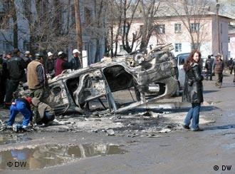 A burnt car in a Kyrgyz street