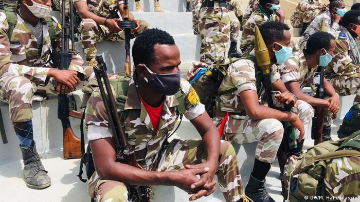 Ethiopian soldiers sit during a military parade in Tigray