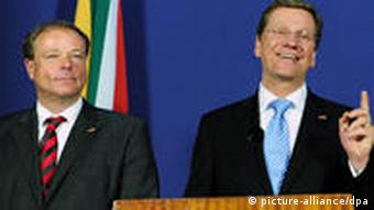Dirk Niebel and Guido Westerwelle speaking from a podium