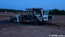 This August 9, 2020** image shows the wreckage of the car where six French aid workers, their local guide and the driver were killed by unidentified gunmen riding motorcycles in an area of southwestern Niger. - Gunmen on motorcycles killed eight people including a group of French aid workers as they visited a part of Niger popular with tourists for its wildlife. (Photo by BOUREIMA HAMA / AFP)