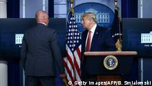 US President Donald Trump is being removed by a member of the secret service from the Brady Briefing Room of the White House in Washington, DC, on August 10, 2020. (Photo by Brendan Smialowski / AFP) (Photo by BRENDAN SMIALOWSKI/AFP via Getty Images)