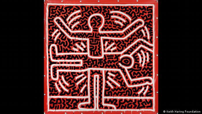 Rechteckiges Keith Haring-Bild mit zwei abstrakten Figuren, die wie ein Kreuz wirken in schwarz, weiß und rot (Keith Haring Foundation)