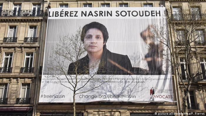A banner showing Nasrin Sotoudeh covers the side of a building in Paris