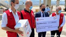 August 12, 2020*** German Foreign Minister Heiko Maas holds a One Million Euros cheque for the Lebanese Red Cross Beirut Emergency Aid upon his arrival in Beirut, Lebanon, August 12, 2020. REUTERS/Andreas Rinke