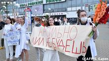 Women dressed in white clothes protest against police violence during recent rallies of opposition supporters, who accuse strongman Alexander Lukashenko of falsifying the polls in the presidential election, in Minsk on August 12, 2020. The placard reads Love cannot be forced. (Photo by Sergei GAPON / AFP)