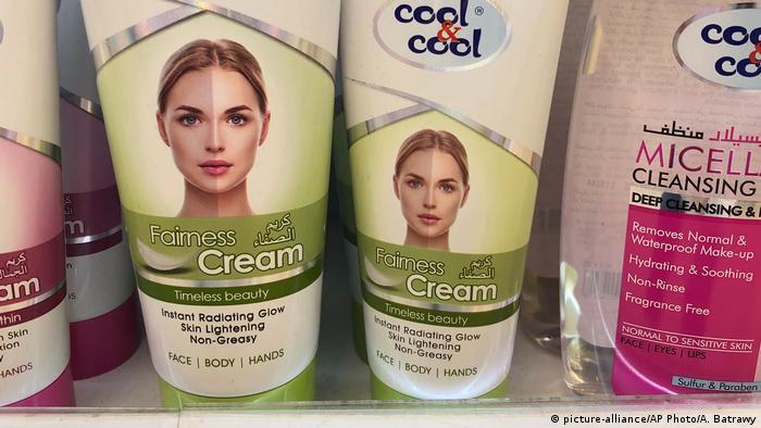 Skin lightening creams being displayed on a shelf