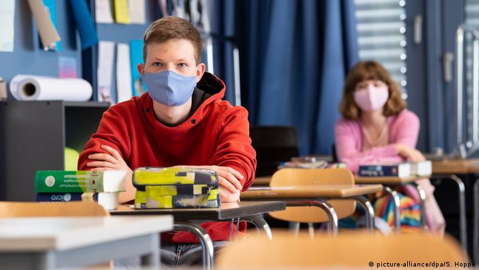 Students wearing a mask in a class room.