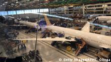 Planes are seen under construction at a Boeing assembly plant in North Charleston, South Carolina on March 25, 2018. The sparkling new Boeing 787s bound for China Southern Airlines and Air China are waiting to be delivered but the prospect of a trade war could make for a less rosy future. / AFP PHOTO / Luc OLINGA (Photo credit should read LUC OLINGA/AFP via Getty Images)