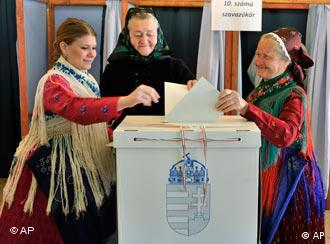 Three Hungarian women cast their ballots