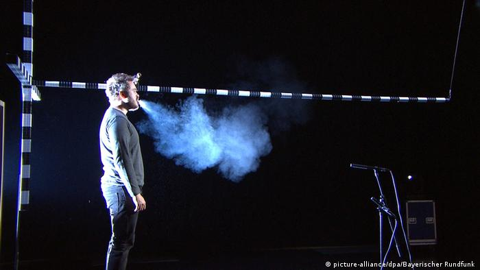An experiment with a man singing - showing the extent of his breath reaching deep into the room.