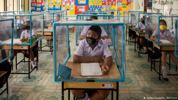 Thai students wear face masks and sit at desks with plastic screens (Getty Images/L. DeCicca)
