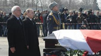 Russian Prime Minister Vladimir Putin, right, and Polish Ambasador to Russia Jerzy Bahr, left, stand next to the coffin of Polish President Lech Kaczynski during a farewell ceremony at the Smolenk airport