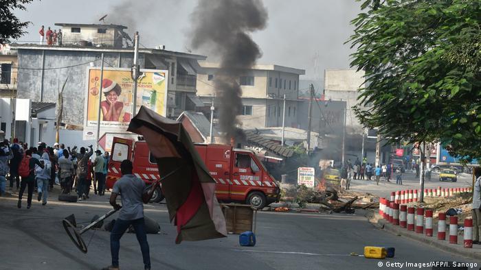 Protesters block a street in Abidjan