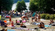 people sunbathing at Berlin Schlachtensee (Imago Images/Jochen Eckel)