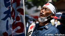 August 15, 2020*** Members of a far right group parade at the entrance of the Yasukuni shrine in Tokyo on August 15, 2020 to mark the 75th anniversary of Japan's surrender in World War II. - The controversial shrine honours 2.5 million war dead but also top World War II criminals and has frequently been a source of sour relations with countries that bore the brunt of Japan's aggression. (Photo by Charly TRIBALLEAU / AFP)