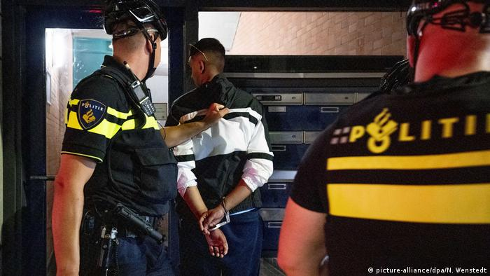 A man is handcuffed by police in The Hague