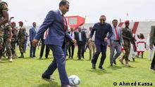 Bild:- Ethiopian Defence minister Lemma Megersa und PM Abiy Ahmed Titel:- Lemma has the ball......Lemma dribbles past the left back and squares the ball to Abiy.... and Abiy sends the goalkeeper the wrong way and puts the ball in the back of the net. Meanwhile, Alemu who is apprehensive after scoring an own goal in the first half watches on from the back. Autour/Copyright:- Ahmed Kassa