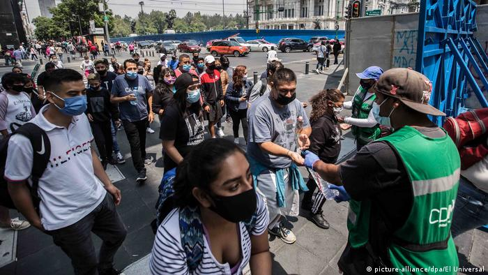 A crowd of people wearing face masks in Mexico City