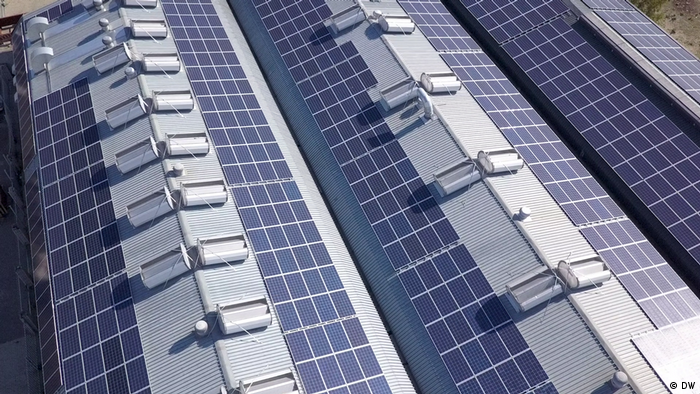 A roof filled with solar panels