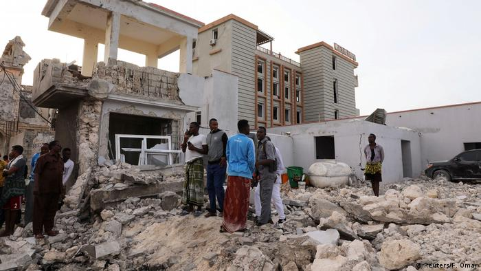 Somalians gather after a bomb attack on a hotel