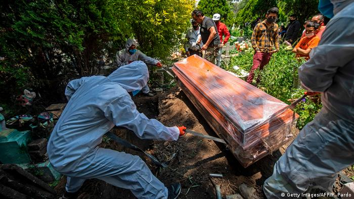 Gravediggers work during a funeral at the San Isidro cemetery in Azcapotzalco, in Mexico City